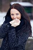 Cute Woman Outdoors in a Cold Park