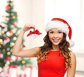 woman in santa helper hat with jingle bells