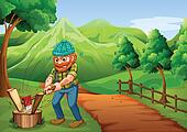 A lumberjack chopping the woods at the pathway going to the farm