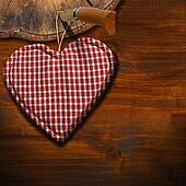 Cloth Heart on Brown Wood Background