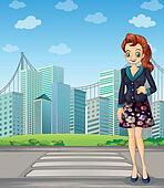 A tall woman standing near the pedestrian lane