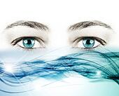 blue eyes and a wave of crystal water on white background