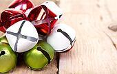 Christmas jingle bells on a  plank
