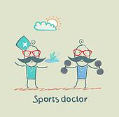 Sports doctor gives a healthy meal to the person who holds the dumbbells
