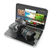 Digital photo camera and laptop. Journalist  or  traveler equipment. 3d