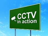 Safety concept: CCTV In action and Cctv Camera on road sign background