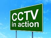 Safety concept: CCTV In action on road sign background