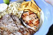 T-Bone steaks and salmon.