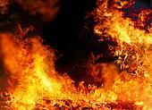 Burning fire background on black