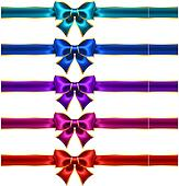 Holiday bows with gold border and ribbons