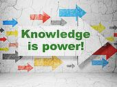 Education concept: arrow whis Knowledge Is power! on grunge wall background