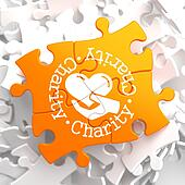 Charity Concept on Orange Puzzle.