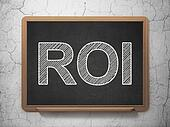 Business concept: ROI on chalkboard background