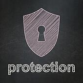 Protection concept: Shield With Keyhole and Protection on chalkboard background