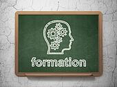 Education concept: Head With Gears and Formation on chalkboard background