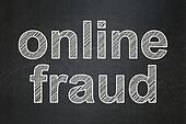 Safety concept: Online Fraud on chalkboard background