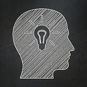 Marketing concept: Head With Light Bulb icon on Black chalkboard background, 3d render