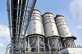 Large factory silo under blue sky