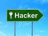 Safety concept: Hacker and Key on road sign background