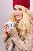 Winter girl drinking tea.