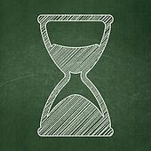 Time concept: Hourglass on chalkboard background
