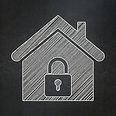 Protection concept: Home on chalkboard background