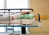 Patient Lying On Bed In Hospital