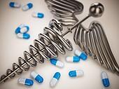 Pills and caduceus pharmacy symbol.