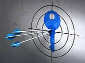 Safety concept: arrows in Key target on wall background