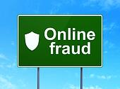 Safety concept: Online Fraud and Shield on road sign background