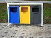Colorful waste baskets in metal frame
