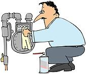 Man cleaning a gas meter