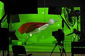 shooting in studio with a green background