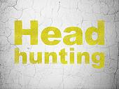 Finance concept: Head Hunting on wall background