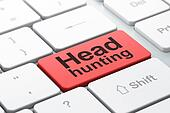 Business concept: Head Hunting on computer keyboard background