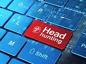 Finance concept: Head With Gears and Head Hunting on computer keyboard background