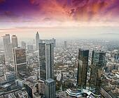 Sunset over a modern city skyline