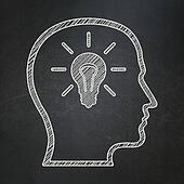 Education concept: Head With Lightbulb on chalkboard background